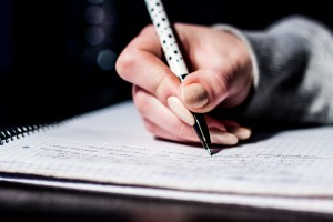 image of a pen writing - perhaps preparing for content testing