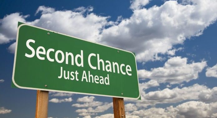 "A road sign that says ""second chance just ahead"""