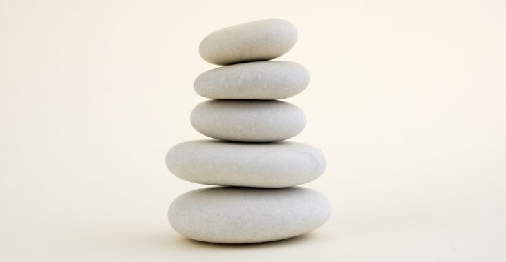 A cairn of small white, round, rocks