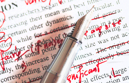 An editor's red pen crossing out words